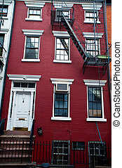 Red building - Red brick apartment building with a fire...