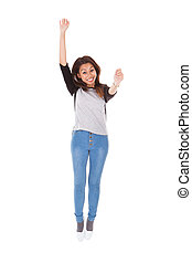 Excited Woman Jumping Against White Background - Full length...