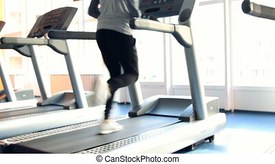 Run on a machine - People at the gym exercising Run on a...