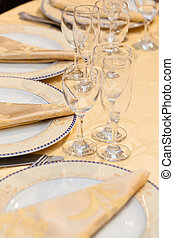 Placesetting - restaurant table with dishes, napkins,...