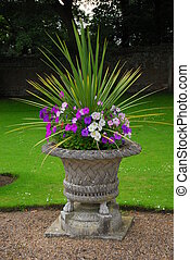 A Decorative Stone Garden Urn with Plants - an old...