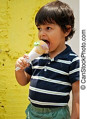 Little boy eating ice cream