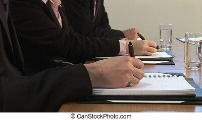 Businessmen signing
