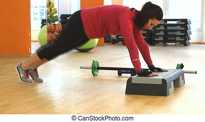 Young woman doing fitness exercise