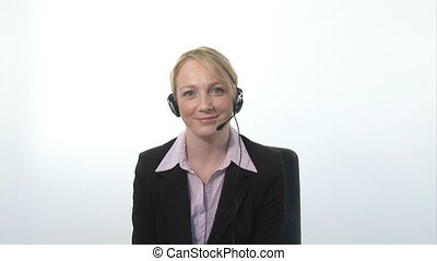 Businesswoman Talking on Headset - Broadcast Quality Stock...