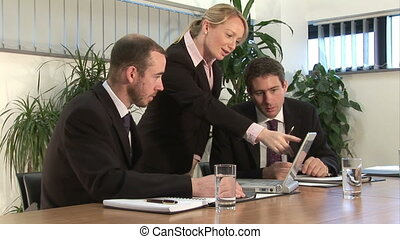 Working on a project - A businessman discusses a project on...