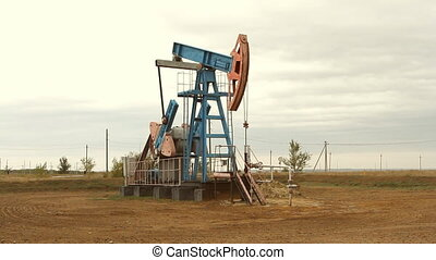 Oil and gas industry Work of oil pump jack on a oil field
