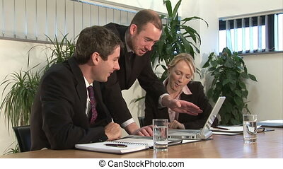 Business Project - A businessman discusses a project on a...