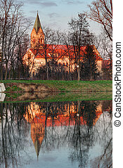 Church with reflection in pond, Cifer