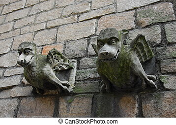 Two Gargoyles - two old gothic stone gargoyles