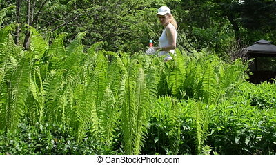 woman water fern plant - Attractive young woman girl with...