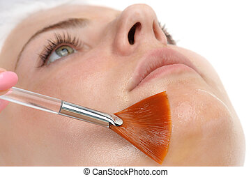 facial peeling mask applying - beauty salon, facial peeling...
