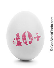 White egg with pink stamp 40+ isolated on white