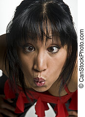 crazy woman - portrait of a young pretty asian woman with...
