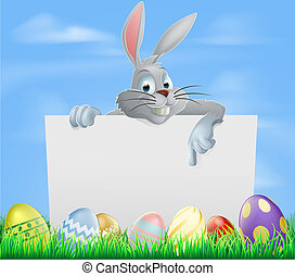 Easter eggs and bunny sign - The Easter bunny pointing at a...