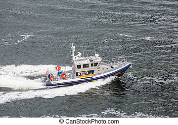 NYPD Boat Cruising Through Harbor - A New York City Police...