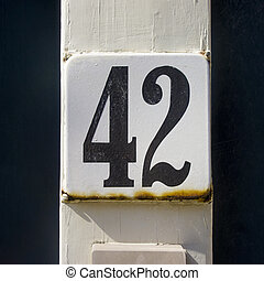 Number 42 - enameled house number fourty two Black lettering...