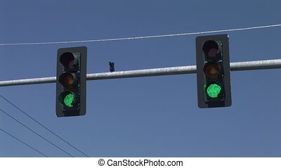 Traffic Signal - Two traffic signals changing from green to...