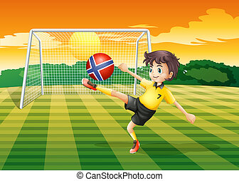 A girl at the field kicking the ball with the flag of Norway
