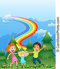 A happy family near the pine trees with a rainbow in the sky...