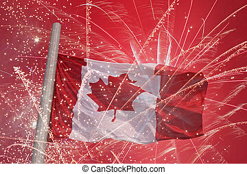flag of Canada over fireworks