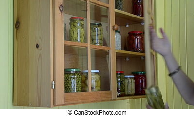hand put glass jar food - Girl hand put canned pickled glass...