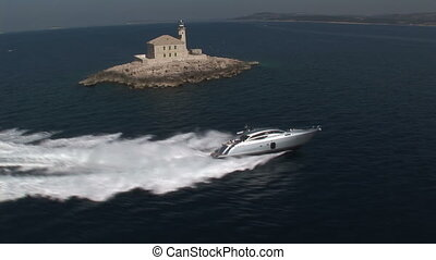 Aerial view of luxury boat sailing in the Mediterranean sea,...