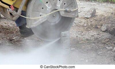 Worker cut concrete brick - Concrete brick cutting with...