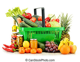 Plastic shopping basket with groceries isolated on white...