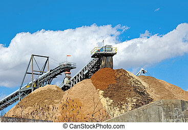 Stock Pile of Saw Dust - Conveyor Dumping Wood Chips and...