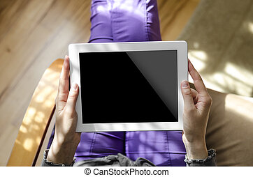 Tablet computer - Woman holding a tablet computer sitting in...