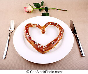 Food concept - eating for love - Fresh Pretzel in heart...