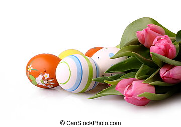 Easter eggs and pink tulips isolated