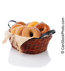 Basket of Bagels - A basket of assorted bagels on a white...