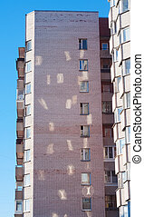 Sunbeams from windows on wall of multistory building