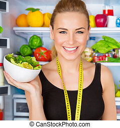 Dietitian with fresh salad - Closeup portrait of beautiful...
