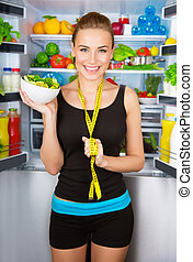 Girl with healthy food - Portrait of beautiful cheerful girl...