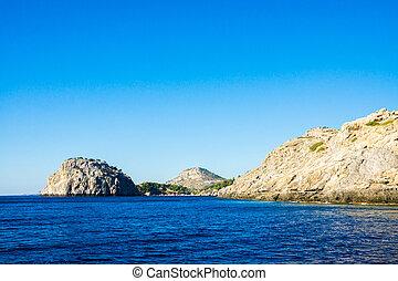 sea sky and mountains - Blue sea sky and mountains near...