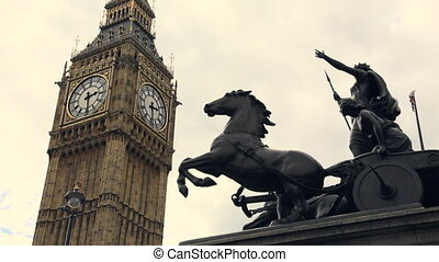 Big Ben clock tower and statue in London, England