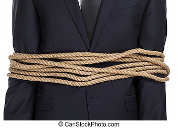 Close up of businessman tied with the rope, isolated on...