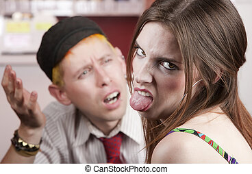 Bad Date - Young woman making rude gesture on a bad date