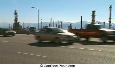 Highway traffic and oil refinery