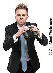 Businessman with binocular - Businessman wearing suit with...