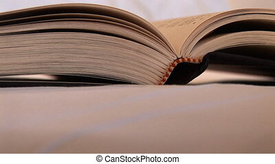 Book on Bed - Open book on a bed, Seattle, Washington, zoom...