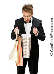 Portrait of businessman looking in shopping bags