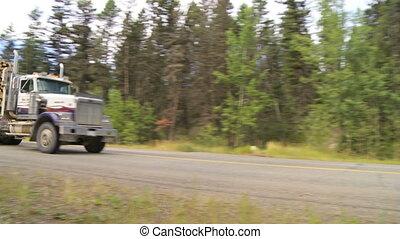 Logging Trucks - Logging trucks transporting logs to lumber...