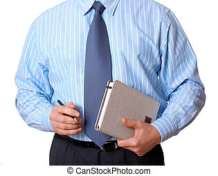 Businessman in blue shirt with appointment book and pen