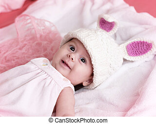 Portrait of a cute little girl dressed in Easter bunny