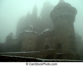 Castle in Mist Austria - Haunted castle during winter in the...