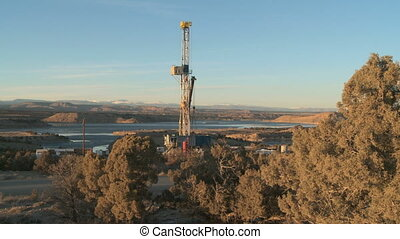 Oil tanker truck passes drill rig, Utah, USA